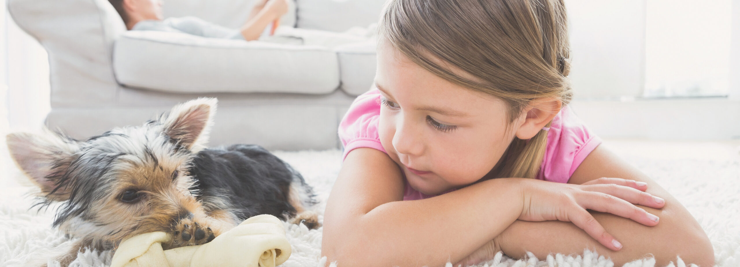 girl kid hanging out with puppy