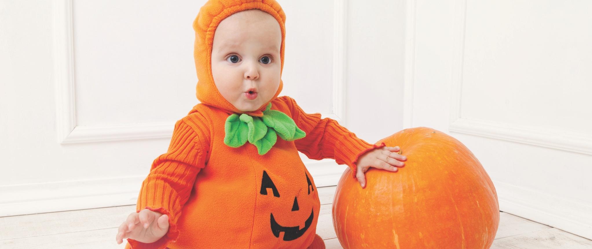 kid as pumpkin w pumpkin smllr
